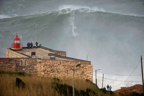 Garrett McNamara surfing on a giant wave in Nazaré Portugal
